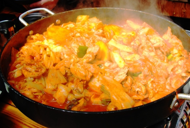 spicy marinated chicken, cabbage, sweet potatoes, onions, tteok, dak galbi , gochujang - Seoul Food - Korean Food