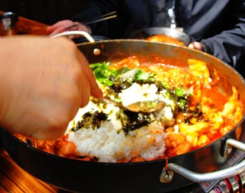 Rice added to Dak Galbi - Korean Food - Chuncheon Specialty Food - Spicy Chicken