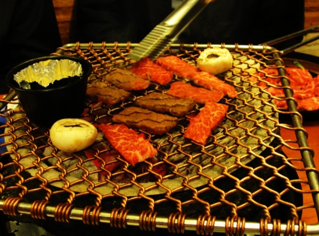 Korean BBQ - Grilling meat - charcoal grill - Korean Food - grilled mushrooms