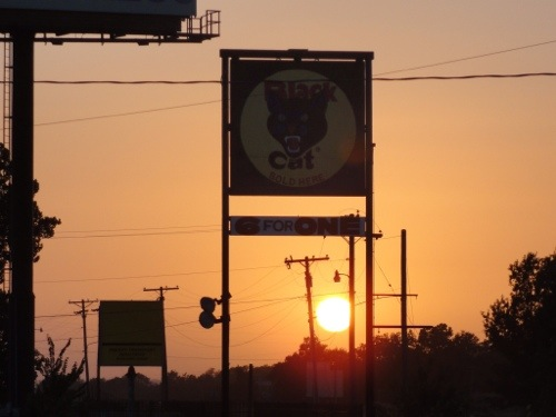 Black cat fireworks - sunset - Missouri - signs