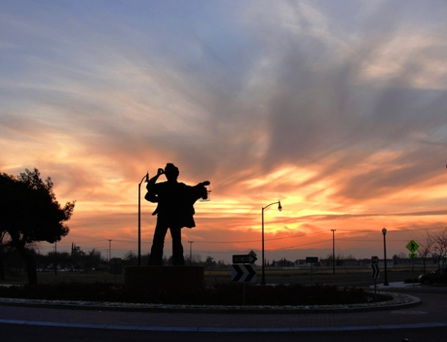Sunset on the Harvest of Progress - Sculpture - Tracy, California - Silhouetted Sculpture - California Sunset