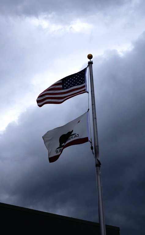 California Flag - US Flag - DMV - Department of Motor Vehicles - Cloudy Sky