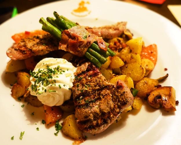 Special platter, pork steak, fried potatoes, bacon, beans