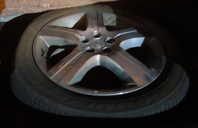 Tire in Trunk, flat, donught tire. car trouble