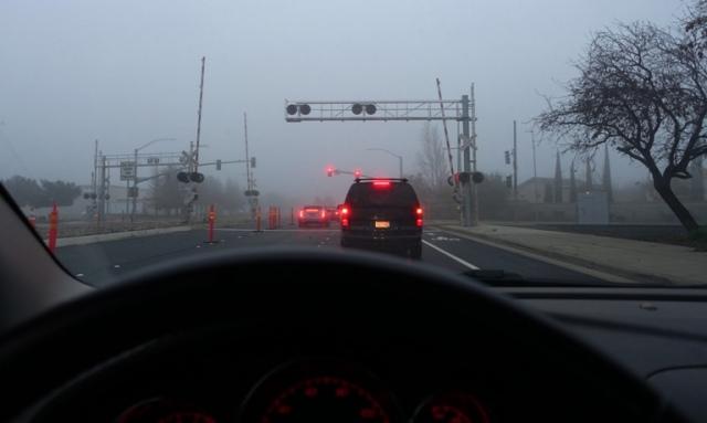 Railroad crossing, fog, commute