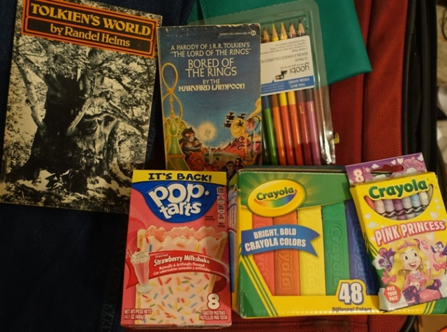 Luggage Items, gifts, chalk, pop tarts, pencils, colors
