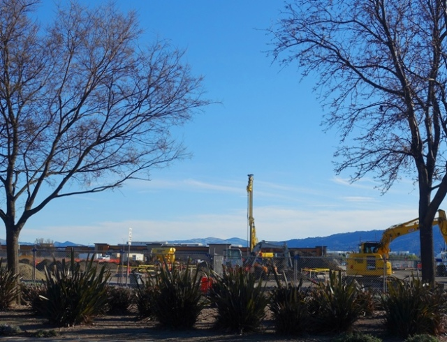 Construction Site, Pile Driver, Trees Budding, Spring
