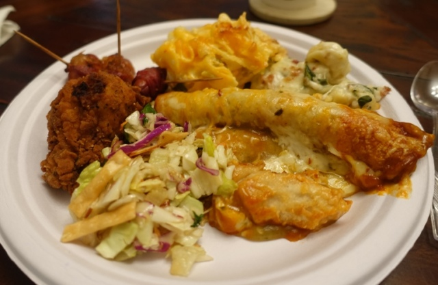 Potluck plate, enchiladas, fred fried chicken, salad