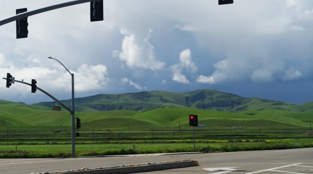 Patterson Hills, Storm Clouds, stoplight, green hills