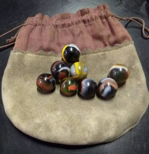 marbles, marble pouch, playing marbles