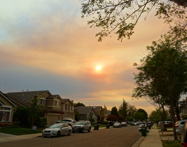 California wild fires, red sky, smoky sky, red tinged clouds