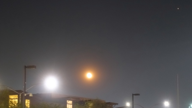 orange full moon, saturday night, smoky sky