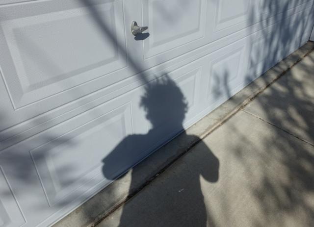 April Shadows, curly hair, need a haircut, Covid hair
