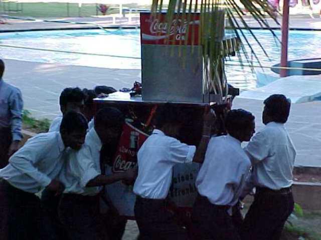 India, manual labor, coke machine, Dominion Resort, Bangalore, how many